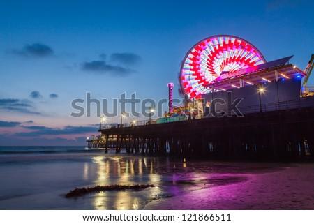 Santa Monica Pier and beach after sunset, California - stock photo