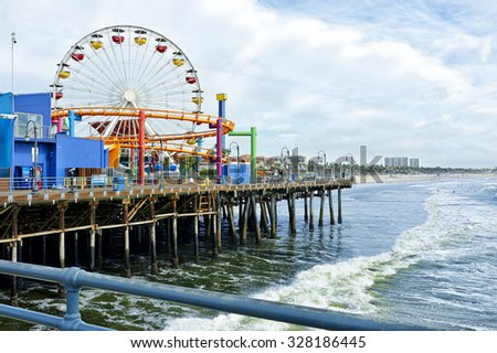 Santa Monica, USA - October 14, 2015: The Santa Monica pier is one of the most popular attractions for tourists in Southern California - stock photo