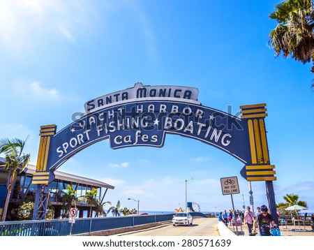 SANTA MONICA, USA - SEP 23, 2014: The welcoming arch of Santa Monica Pier in Santa Monica, USA. The site is an iconic 100-year-old landmark for California visitors. - stock photo