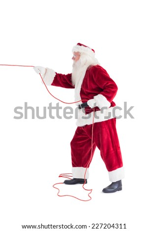 Santa pulls something with a rope on white background - stock photo