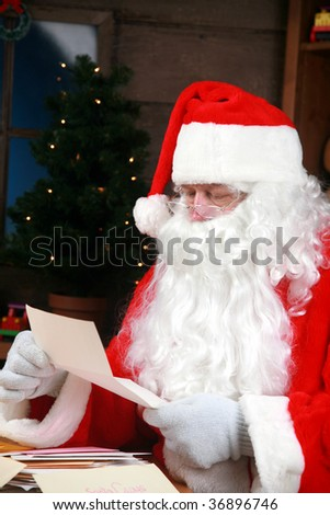 "Santa reads his ""letters to santa"""