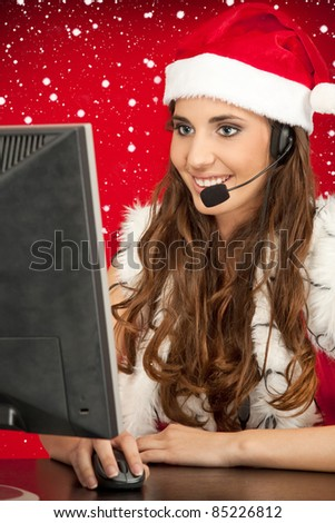 Santa's assistant taking orders from children from mail - stock photo