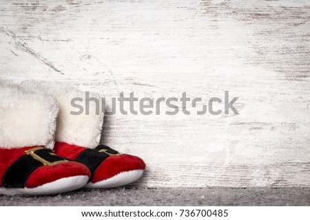 Santa's boots in Christmas background