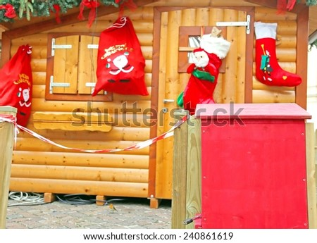 Santa's cottage with the mailbox to post the letters of children - stock photo