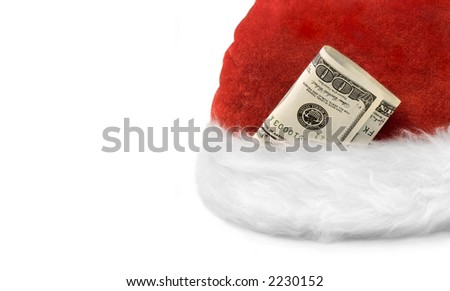 Santa's hat with dollar banknotes on a white background - stock photo