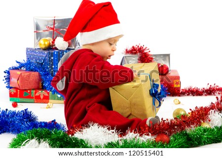 Santa's little helper baby with christmas gifts with white background - stock photo