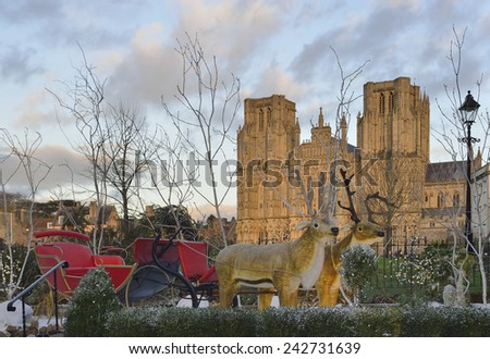 Santa's Reindeer and Sleigh at Wells Cathedral - stock photo