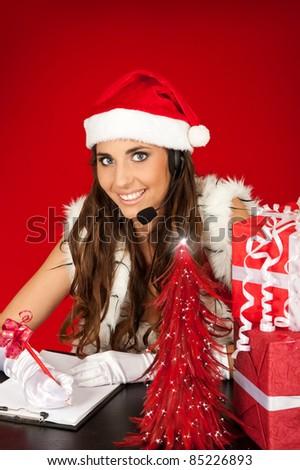 Santa's  secretary writing christmas wishes - stock photo
