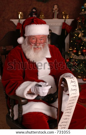 Santa's Smiles Big With His list - stock photo