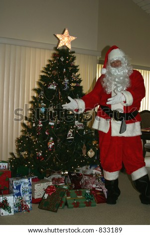 santa shows off the presents he just left - stock photo