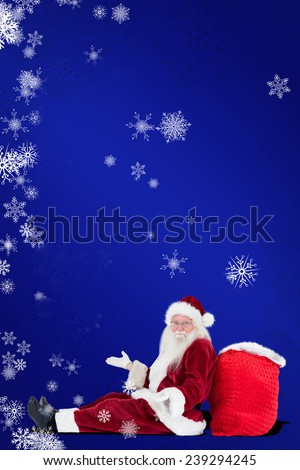Santa sits leaned on his bag and has no clue against blue - stock photo