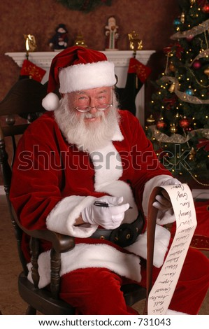 Santa Smiling With His List - stock photo