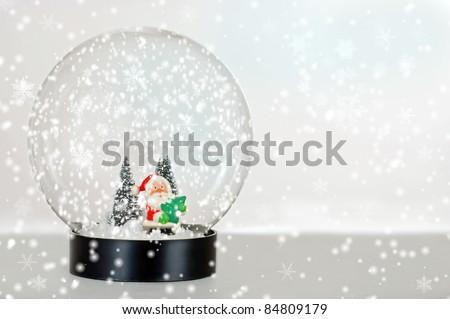 Santa snow globe with falling snow - stock photo