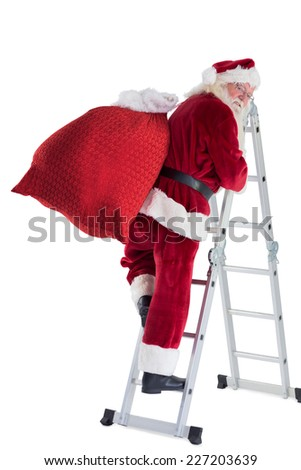 Santa steps up a ladder on white background and looks back - stock photo