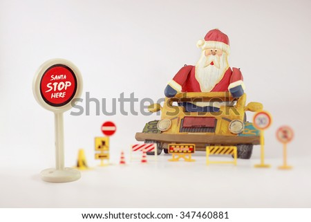 Santa stop here,Santa Claus on his classic vehicles and retro Gasoline pump.Christmas wallpaper ,soft focus and Vintage color. - stock photo