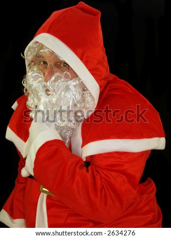 Santa stroking his beard thinking about what to give you - stock photo