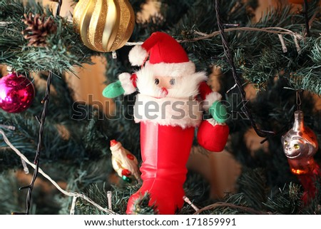 santa toy on Christmas tree decorated