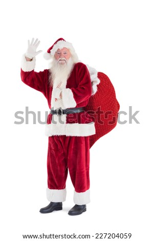 Santa waves to the camera on white background - stock photo