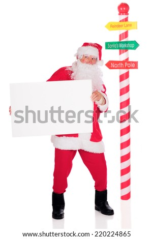 Santa with a Sign - stock photo