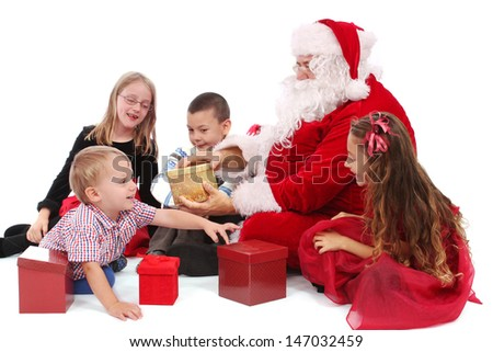 Santa with children, isolated on white - stock photo