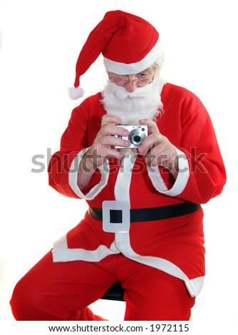Santa with his digital camera - stock photo