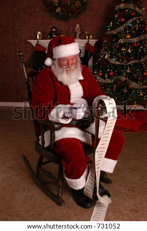 Santa With His Long List - stock photo