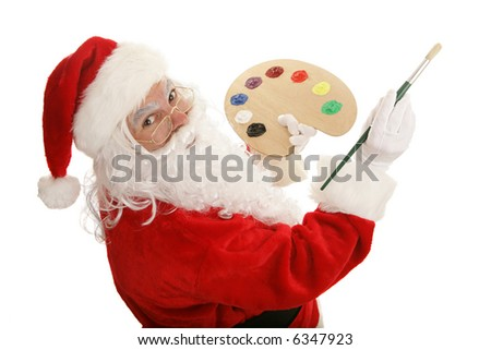 Santa with painting with a colorful paint palette and brush.  Isolated on white. - stock photo