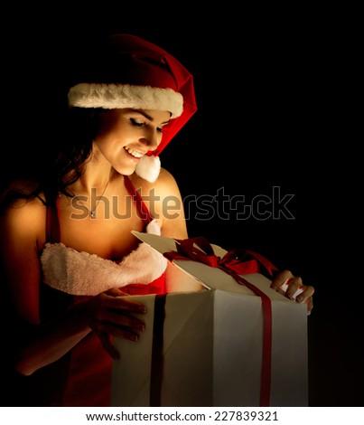 santa woman opening the magical Christmas present box - stock photo