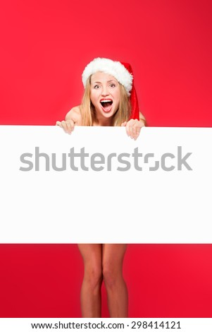 Santa woman pointing at blank whiteboard - stock photo
