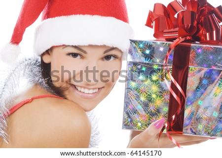 Santa woman showing gift wearing Santa hat. - stock photo