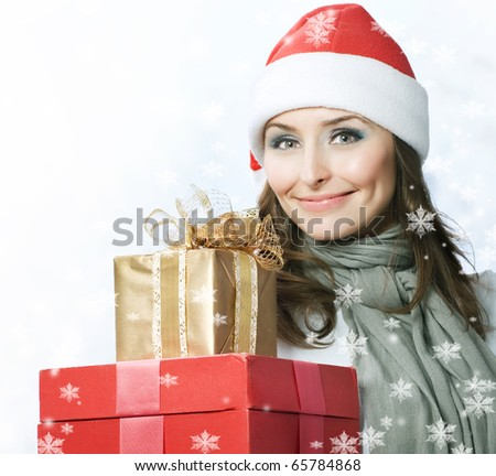 Santa Woman with Christmas Gift Box - stock photo