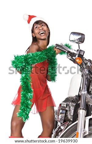santa woman with long hair and red cap next to a bike, isolated on white - stock photo
