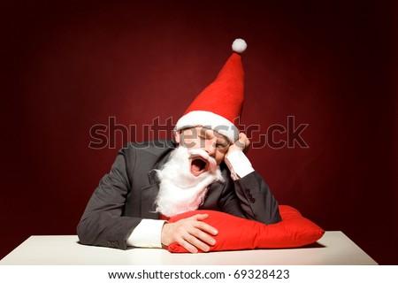 Santa yawning - stock photo