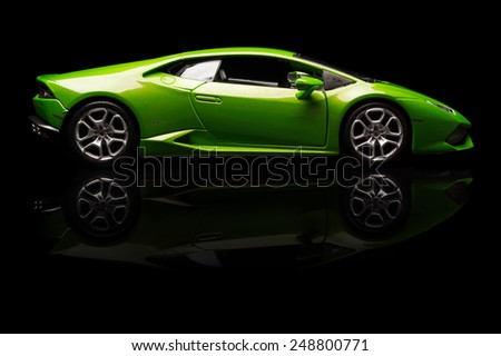 SANTAGATA BOLOGNESE, BOLOGNA, ITALY - JAN 20 - Toy lamborghini huracan on black background, Tuesday 20 January 2015 - stock photo
