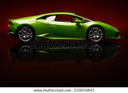 SANTAGATA BOLOGNESE, BOLOGNA, ITALY - JAN 20 - Toy lamborghini huracan on red background, Tuesday 20 January 2015 - stock photo