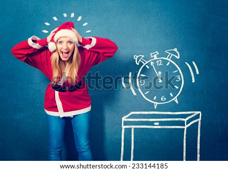 Santagirl with clock five to twelfe - Santagirl - stock photo