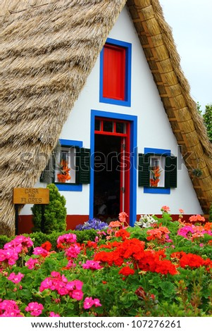 Santana, Madeira, Portugal. Santana is a municipality of the portuguese Madeira island known for the traditional houses with triangular rooftops protected by straw.. - stock photo