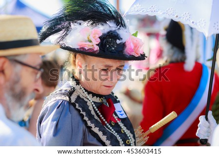 SANTANDER, SPAIN - JULY 16: Unidentified group of adults, dressed of period costume in a costume competition celebrated in July 16, 2016 in Santander, Spain - stock photo