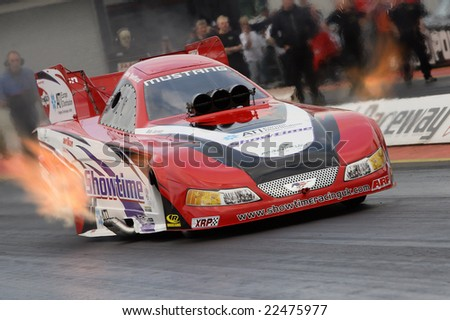 "SANTAPOD ENGLAND – SEPTEMBER 28, 2008: John Spuffard competing in his Top Fuel Funny Car ""Showtime"" at the UK National Finals event 28th September 2008 at Santapod Raceway Raceway, England"