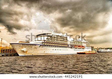 Santarem, Brazil-December 24, 2015: Large luxury cruise ship Seven Seas Navigator anchored at sea at the port of Santarem, Brazil at cloudy day - stock photo