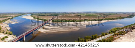 Santarem, Portugal. Dom Luis I Bridge crossing the Tagus River (Rio Tejo), the largest of the Iberian Peninsula, with the Leziria landscape seen from Portas do Sol belvedere.  - stock photo