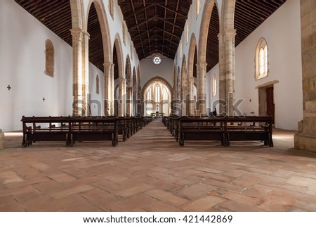 Santarem, Portugal. September 11, 2015: The aisle and Naves of the Santa Clara Church. 13th century Mendicant Gothic Architecture. Santarem is called the Capital of Gothic in Portugal. - stock photo