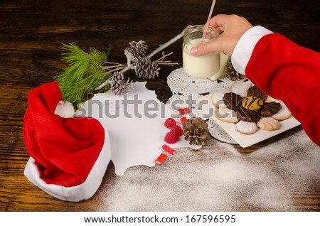 Santas hand taking treats  prepared for him