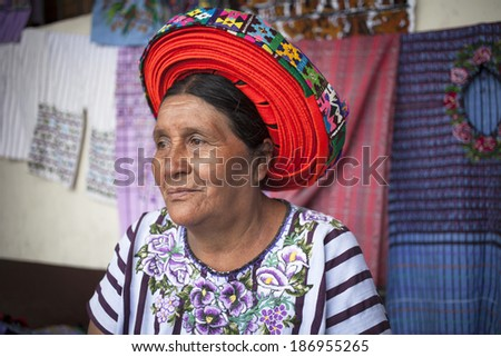 SANTIAGO ATITLAN, GUATEMALA - MARCH 24: Old woman in ethnic traditional Central American dress, Santiago Atitlan, Guatemala, 24 March, 2014. Descendants of Indians Maya still live in Guatemala  - stock photo