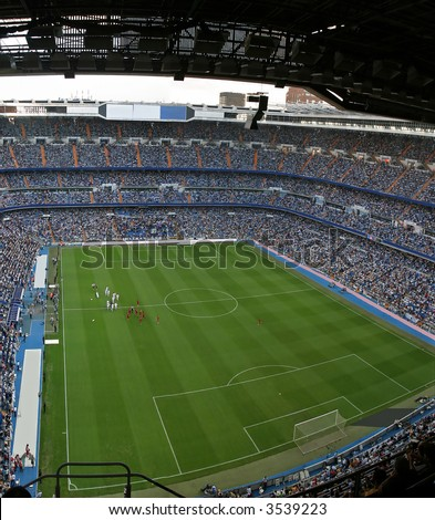 Santiago Bernabeu, soccer stadium full of people - stock photo