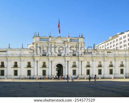 SANTIAGO, CHILE - JAN 25, 2015: people visit the Palacio de la Moneda in Santiago, Chile. The palace was opened in 1805 as a colonial mint, but later became the presidential palace. - stock photo