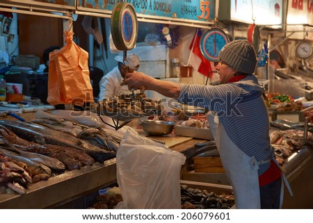 SANTIAGO, CHILE - JULY 8, 2014: Fresh seafood for sale in the historic main fish market in the centre of Santiago, capital of Chile - stock photo