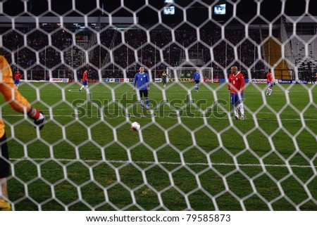 SANTIAGO, CHILE - JUNE 19: Humberto Suazo from Chile (red n9) is ready to kick a penalty during a friendly soccer match played between Chile and Estonia at 19th of June, 2011 in Santiago Chile. - stock photo