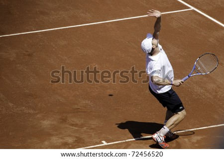 SANTIAGO, CHILE - MAR 4: Andy Roddick from USA during service in the match against  Nicolas Massu from Chile during the first match valid for the Davis Cup. March 4, 2011 in Santiago Chile. - stock photo