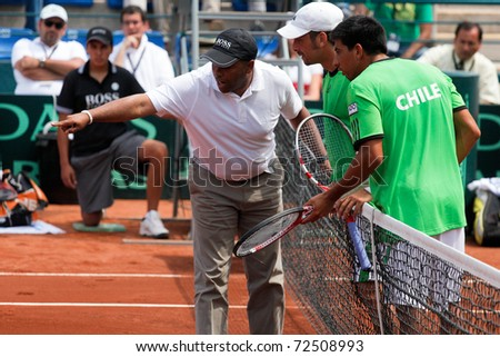 SANTIAGO, CHILE - MAR 5: The chilean couple, Nicolas Massu and Jorge Aguilar argues against the referee at the match against USA  valid for the Davis Cup. March 5, 2011 in Santiago Chile. - stock photo